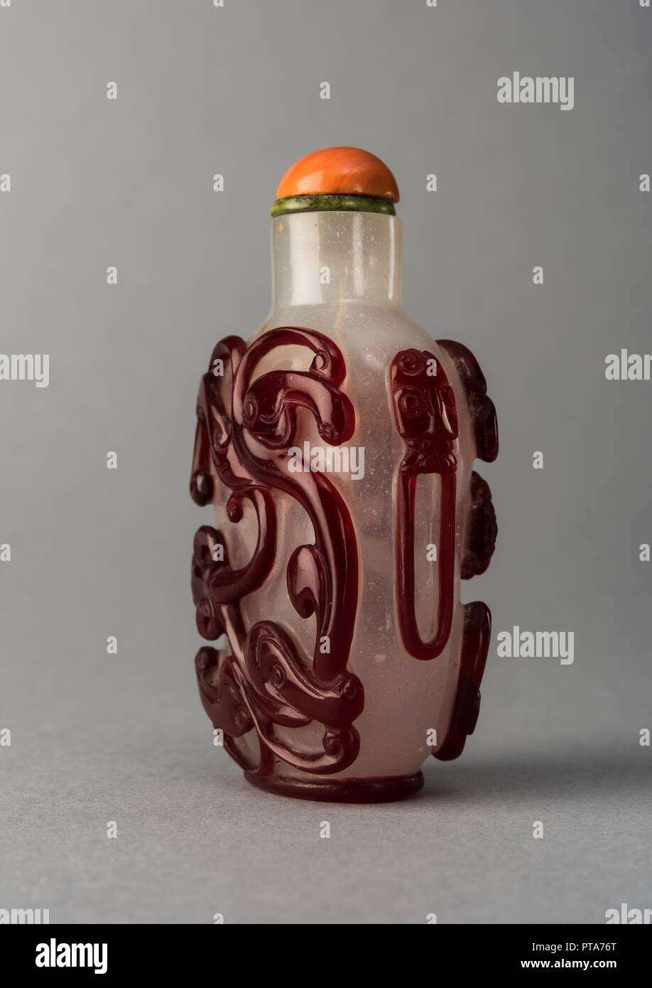 0519113555fe05 Glass snuff bottle, baluster form, clear body with applied decoration in  red glass  stylised animal motifs on main face (dragon on one side ...