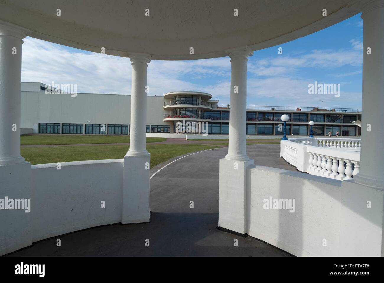 View from the promenade towards the De la Warr Pavilion, an art deco, modernist Grade I listed building built in 1935 by Mendelsohn and Chermayeff, now housing one of the biggest art galleries on the south coast, Bexhill, East Sussex, England. - Stock Image