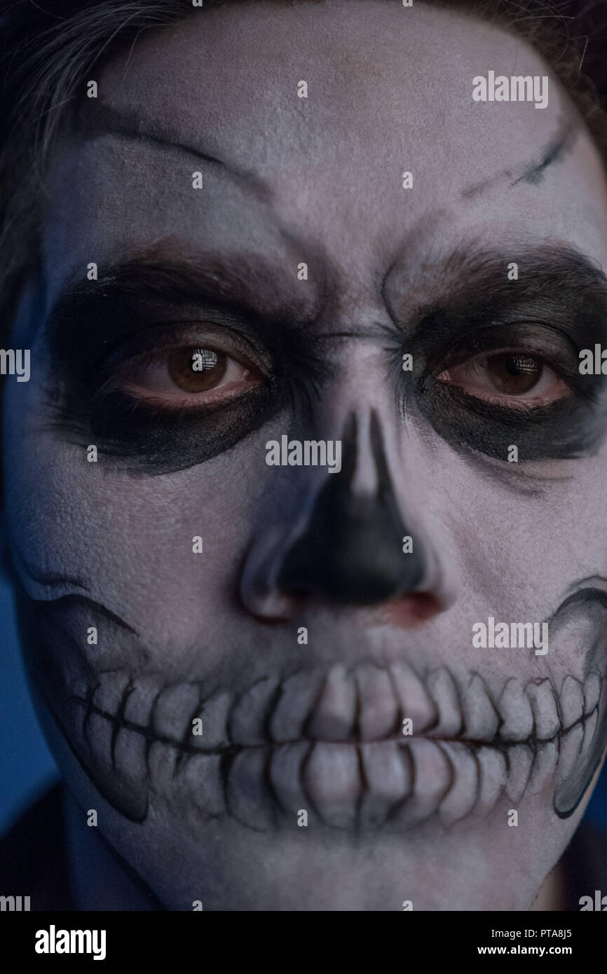 Close-up portrait of a man with a dead man's face on halloween. - Stock Image