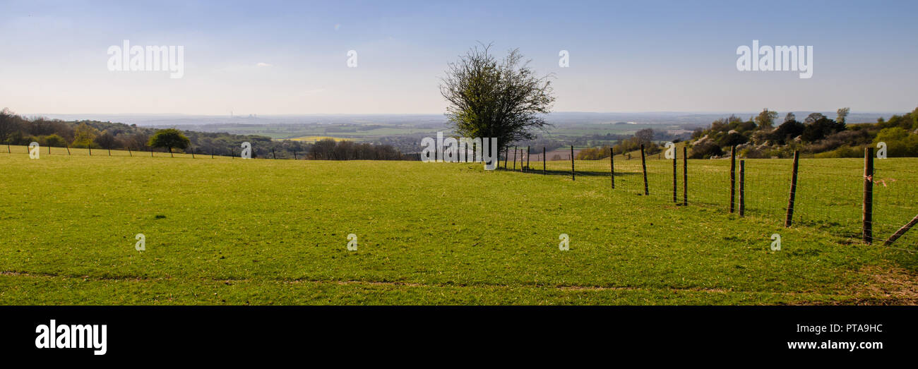 A patchwork of villages and agricultural fields, plus the giant Didcot Power Station, form the Oxfordshire landscape as seen from the summit of the sc - Stock Image