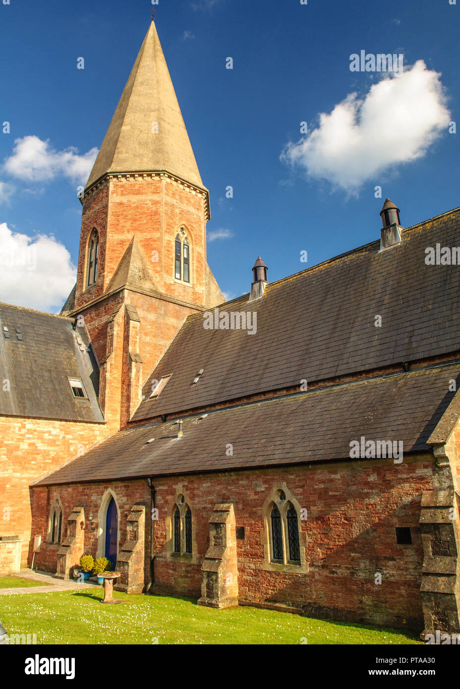 Wells, England, UK - May 25, 2013: Summer sun shines on the former church of the Mendip Hospital at South Horrington near Wells in Somerset, now conve - Stock Image