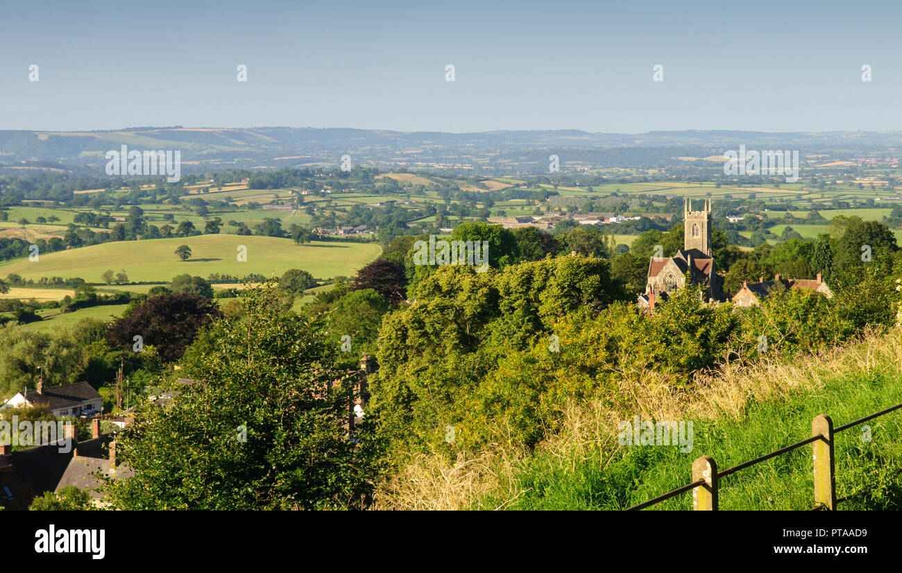 The dairy farmland of the Blackmore Vale presents a patchwork of pasture fields and woodland viewed from Park Walk in the hilltop town of Shaftesbury. - Stock Image