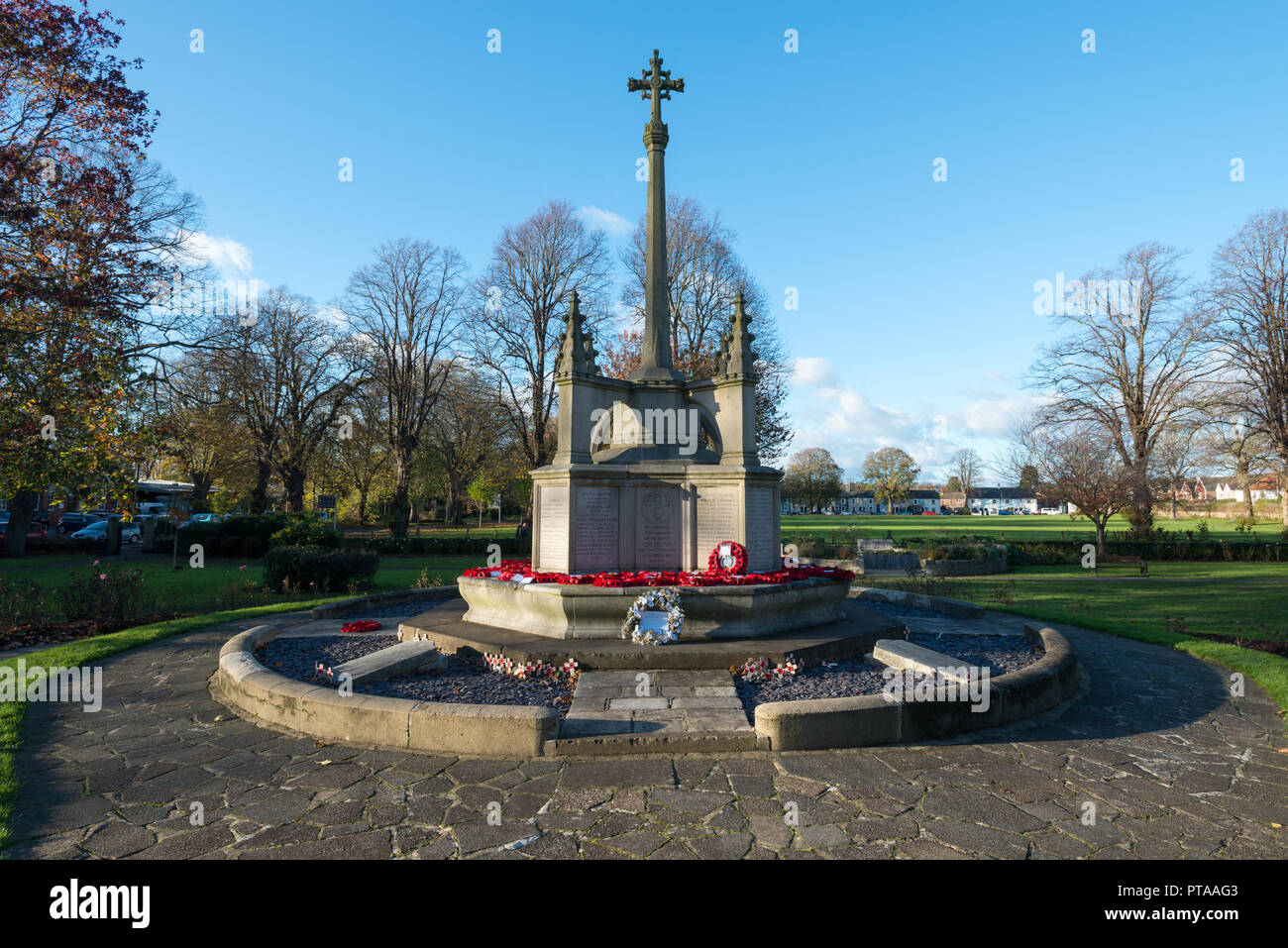 Red poppy wreaths on a war memorial in Chichester, West Sussex, UK.​ - Stock Image