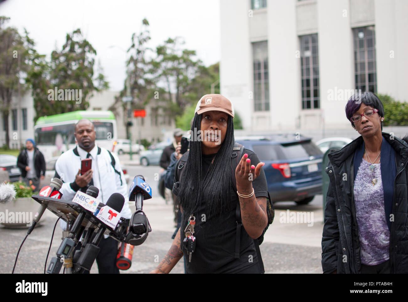 Eliza Anderson, a former tenant at 2551 San Pablo Ave. where a fire killed four people in 2017, discusses a lawsuit at a press conference. Stock Photo