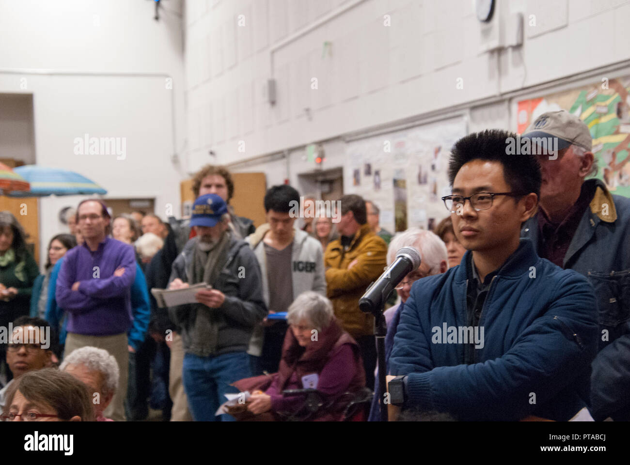 Residents line up to discuss building housing at the North Berkeley BART station at a public meeting at the Berkeley Adult School on March 15, 2018. - Stock Image