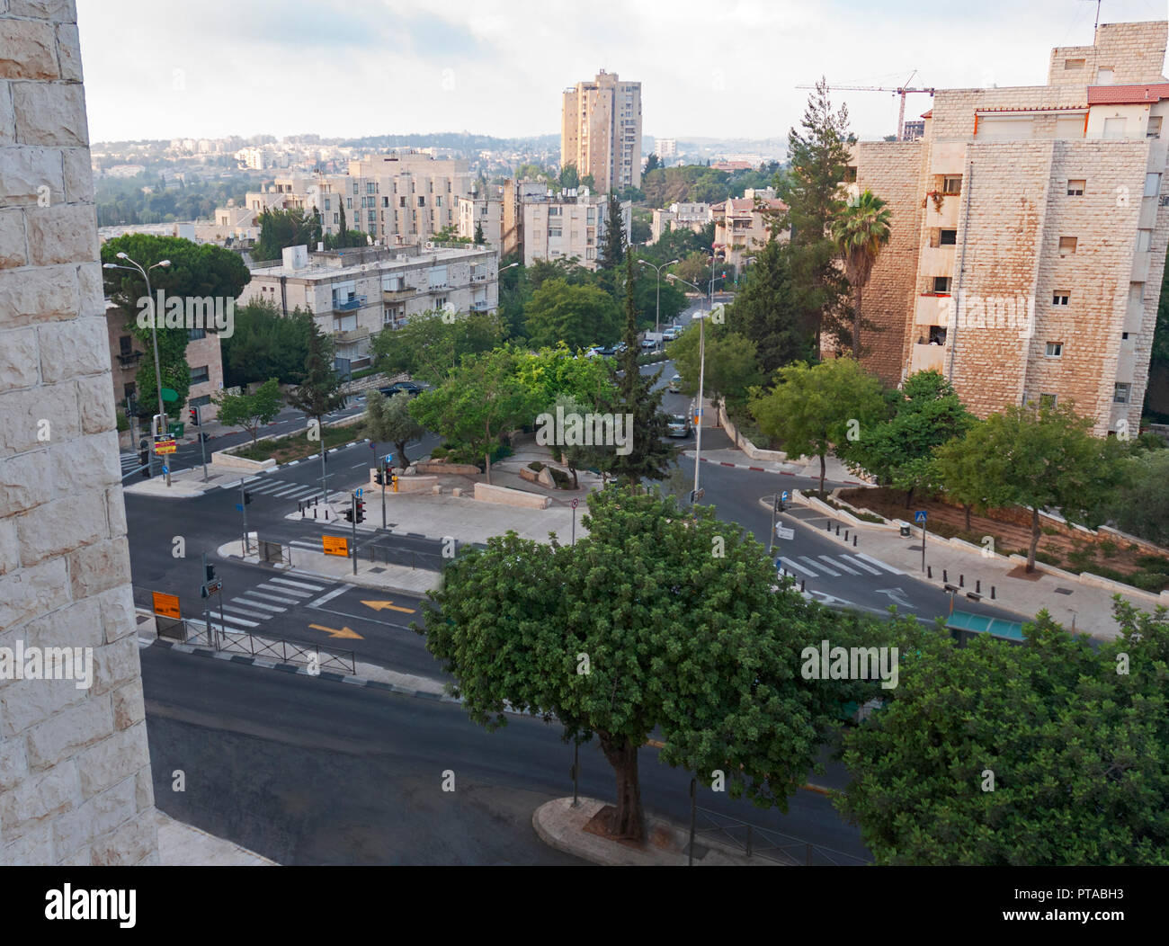 a view of downtown jerusalem at dawn from a hotel window above the deserted streets - Stock Image