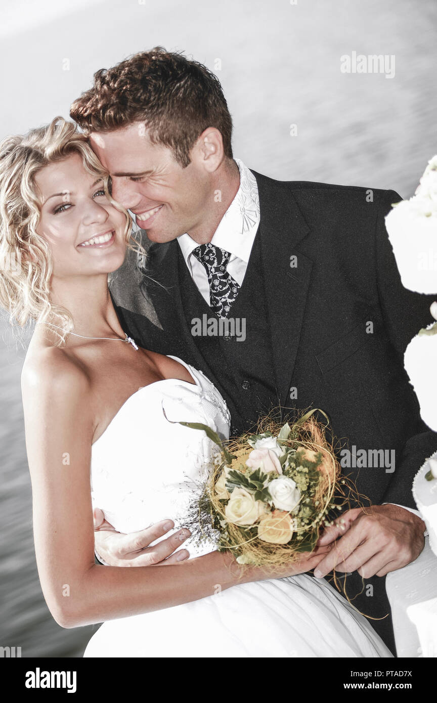bridal couple outside, with weddingcake (model-released) Stock Photo