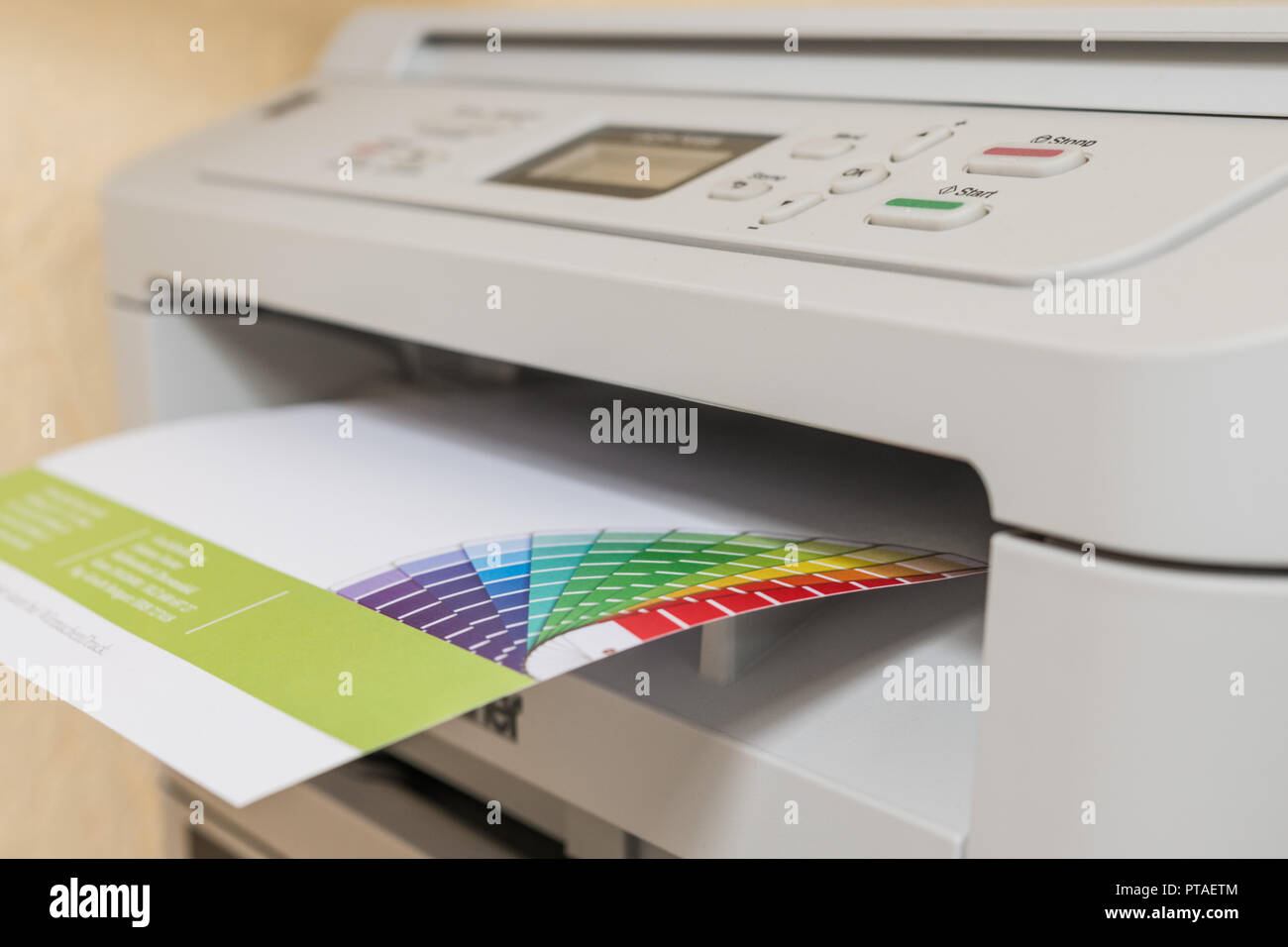 Printed sheet of paper comes out of printer Stock Photo