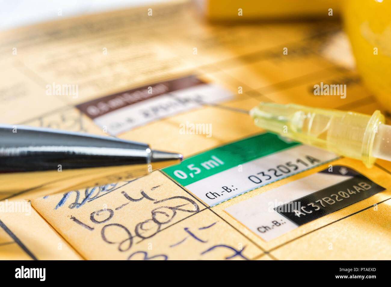Vaccination certificate with stamp and ballpoint pen Stock Photo