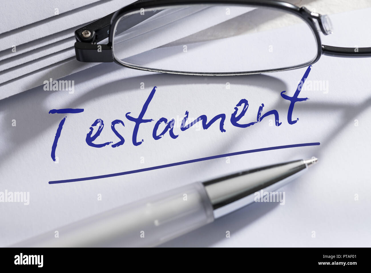 Testament with pen and glasses Stock Photo