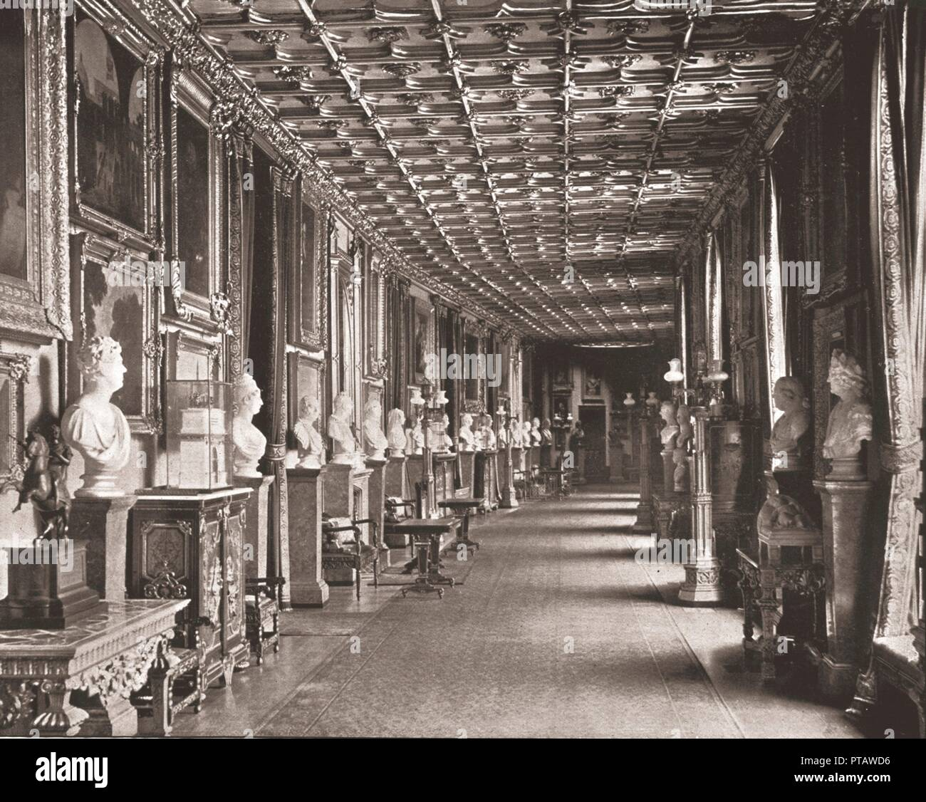 The East Corridor, Windsor Castle, Berkshire, 1894. View inside the royal residence at Windsor, showing sculpted busts lining the walls, commemorating British monarchs, historical personages, friends and contemporaries of George IV. From Beautiful Britain; views of our stately homes. [The Werner Company of Chicago, 1894] - Stock Image