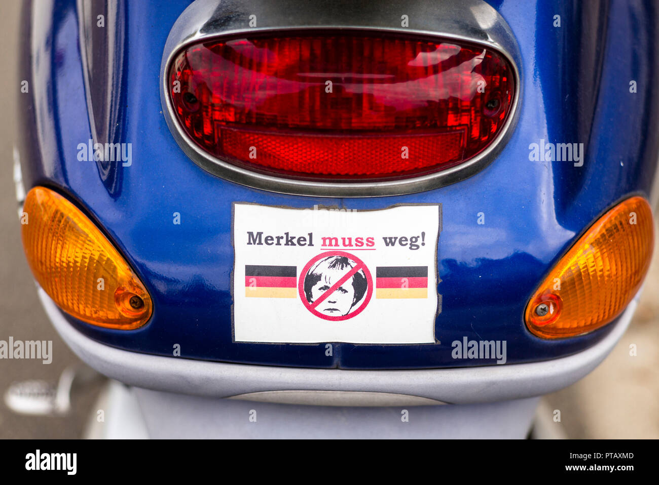 Sticker on a scooter calling for demission of German chancellor Angela Merkel. After 13 years in the office, the politician is widely criticised in he Stock Photo