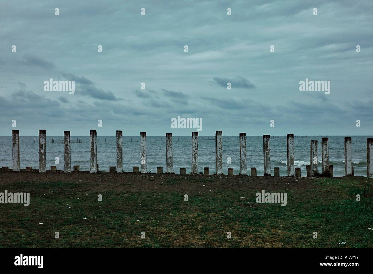 Lankaran, Azerbaijan - APR 18 2011: caspian sea shore with concrete piles and some submerged structure - Stock Image