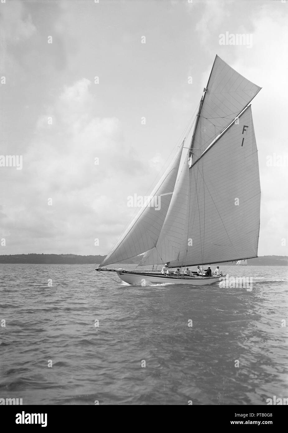 The International 10 Metre class 'Irex' (F1) sailing close-hauled, 1911. Creator: Kirk & Sons of Cowes. Stock Photo