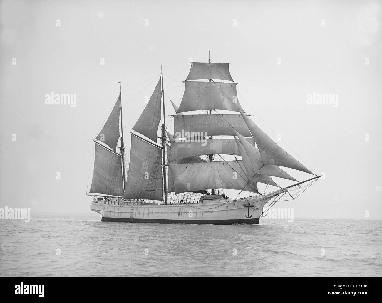 A barquentine rigged ship, 1913. - Stock Image
