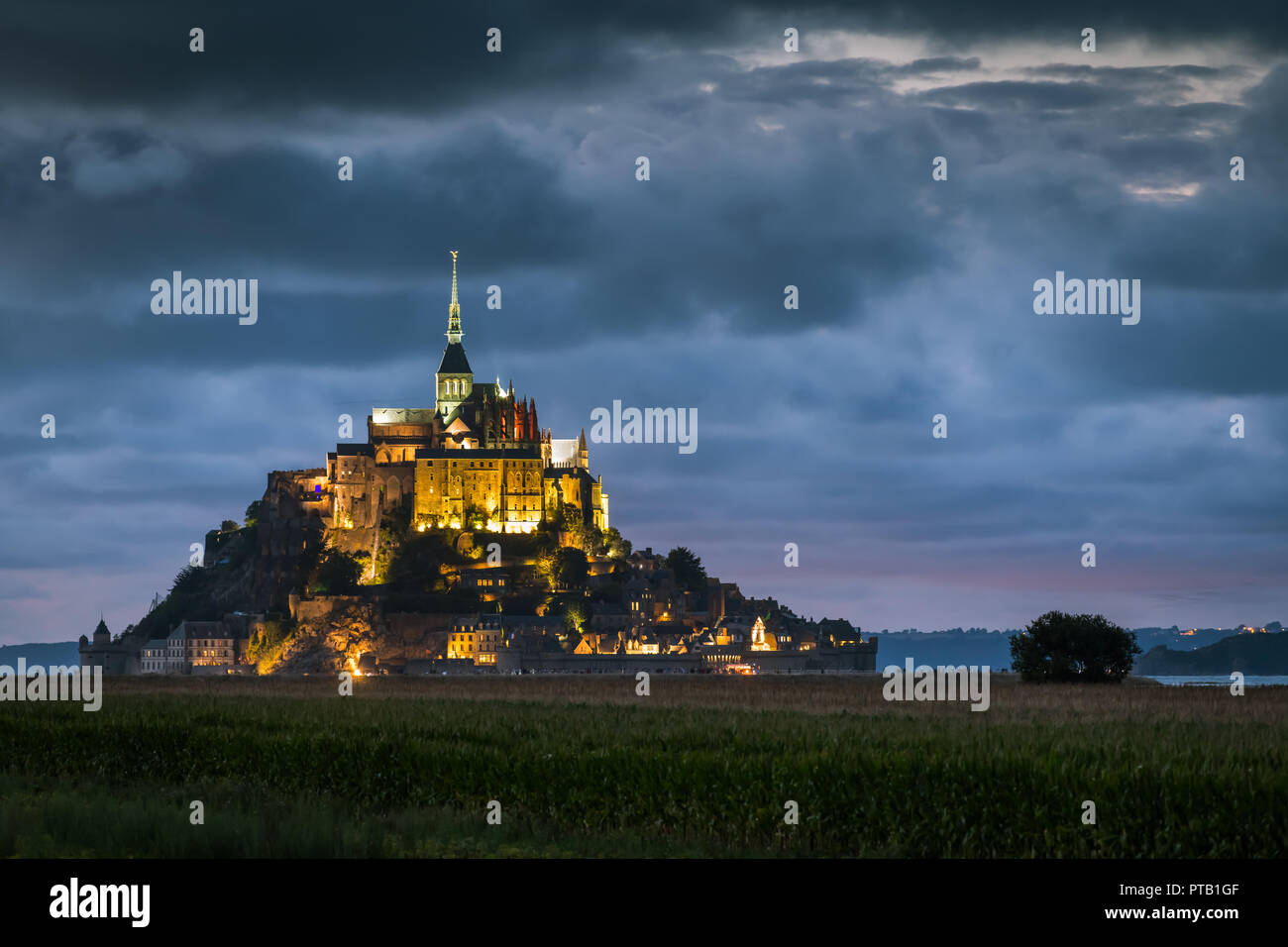 After sunset at Le Mont Saint Michelle (France) in summer, blue hour Stock Photo