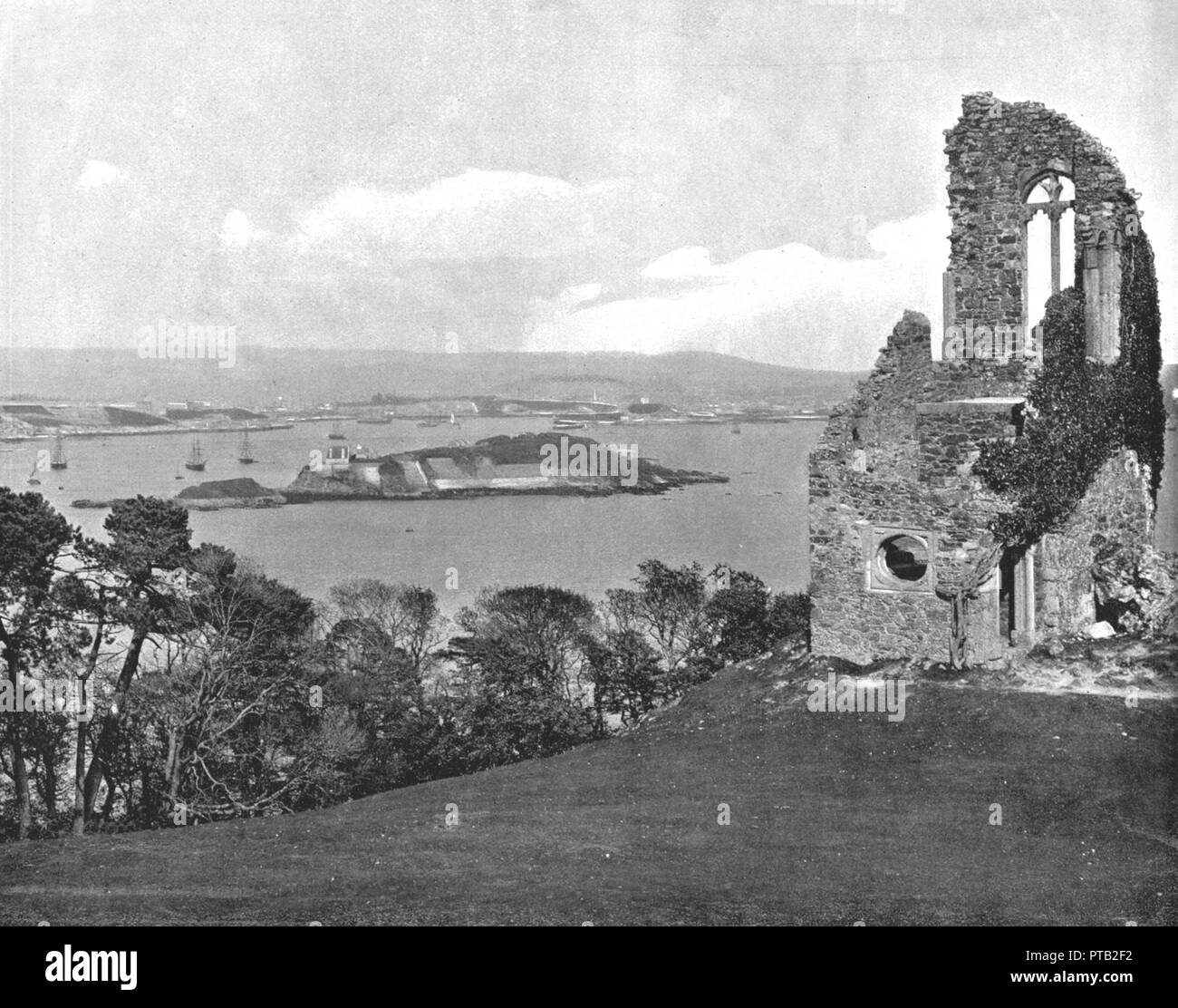 Mount Edgcumbe Folly, Plymouth, Cornwall, 1894. The folly overlooking Plymouth Sound was built as a deliberately ruined stone tower in 1747. From Beautiful Britain; views of our stately homes. [The Werner Company of Chicago, 1894] - Stock Image