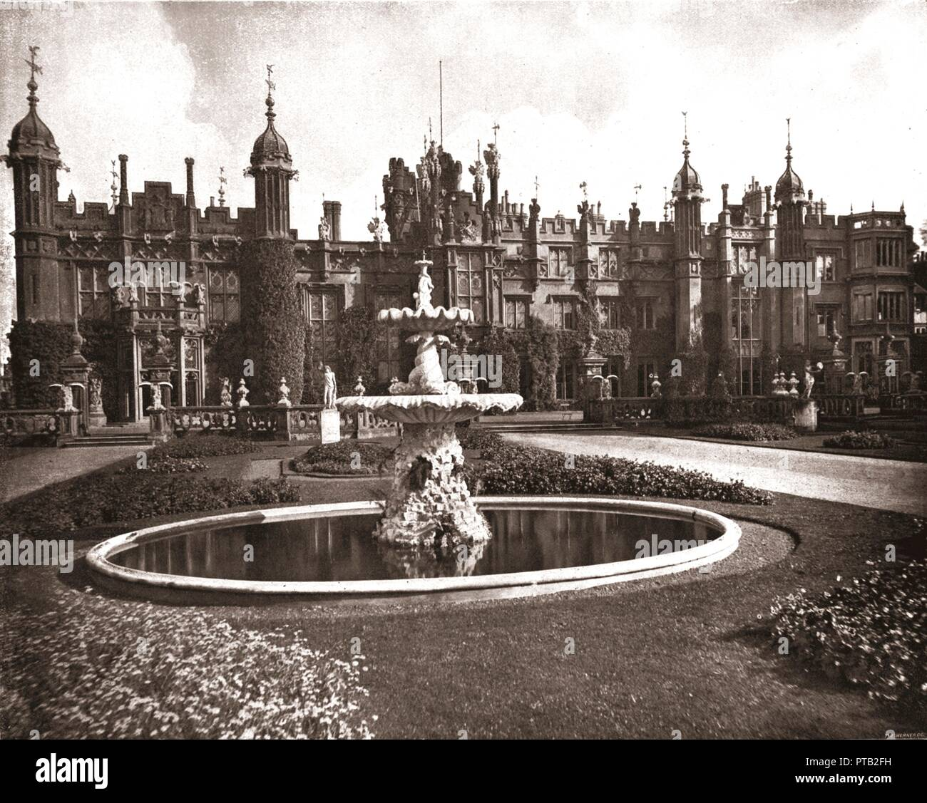 Knebworth House, Hertfordshire, 1894. View of the house and gardens, home of the Lytton family since 1490. The neo-Gothic facade was built in the 19th century. From Beautiful Britain; views of our stately homes. [The Werner Company of Chicago, 1894] - Stock Image