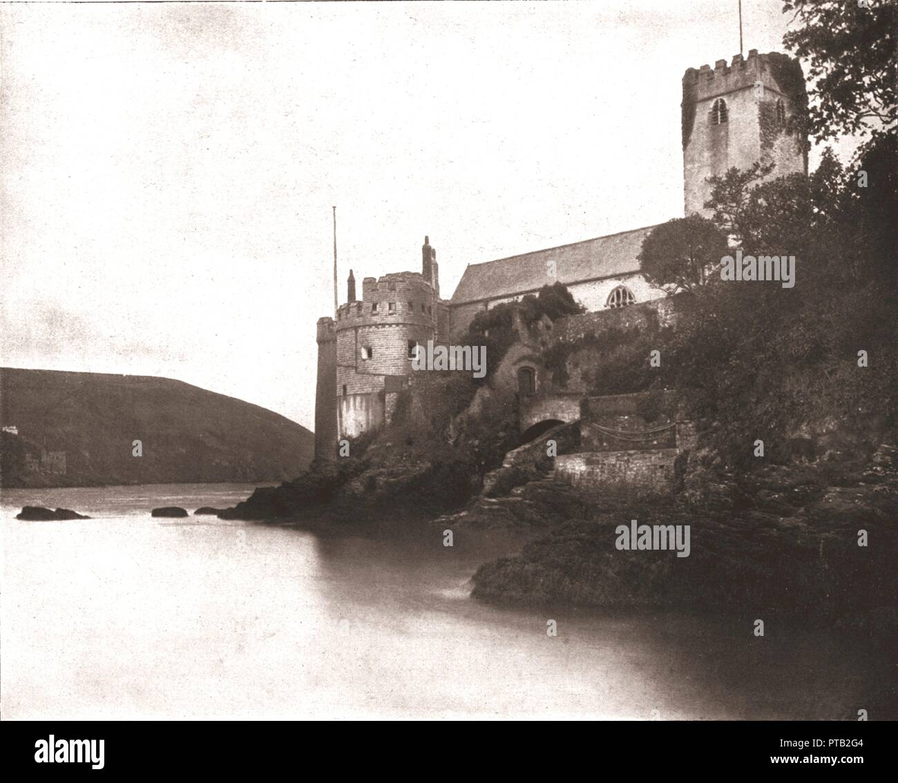 Dartmouth Castle and St Petroc's Church, Devon, 1894. Begun in the late 14th century, the castle stands on a rocky promontory which juts out into the Dart estuary. Built to protect the merchants of Dartmouth, it was one of the earliest castles designed with artillery in mind. From Beautiful Britain; views of our stately homes. [The Werner Company of Chicago, 1894] - Stock Image