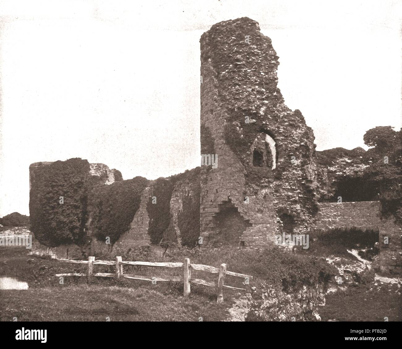 Pevensey Castle, Sussex, 1894. Medieval castle and former Roman Saxon Shore fort. A castle was first built at Pevensey early in the 4th century by the Romans, but it was destroyed by Saxon invaders in the late 5th century. Left derelict for some 600 years, the castle was then rebuilt by Harold Godwinson, Earl of Wessex (later King Harold of England). The Normans made some additions to the castle after 1066 but by Elizabethan times it had fallen into disrepair. From Beautiful Britain; views of our stately homes. [The Werner Company of Chicago, 1894] - Stock Image