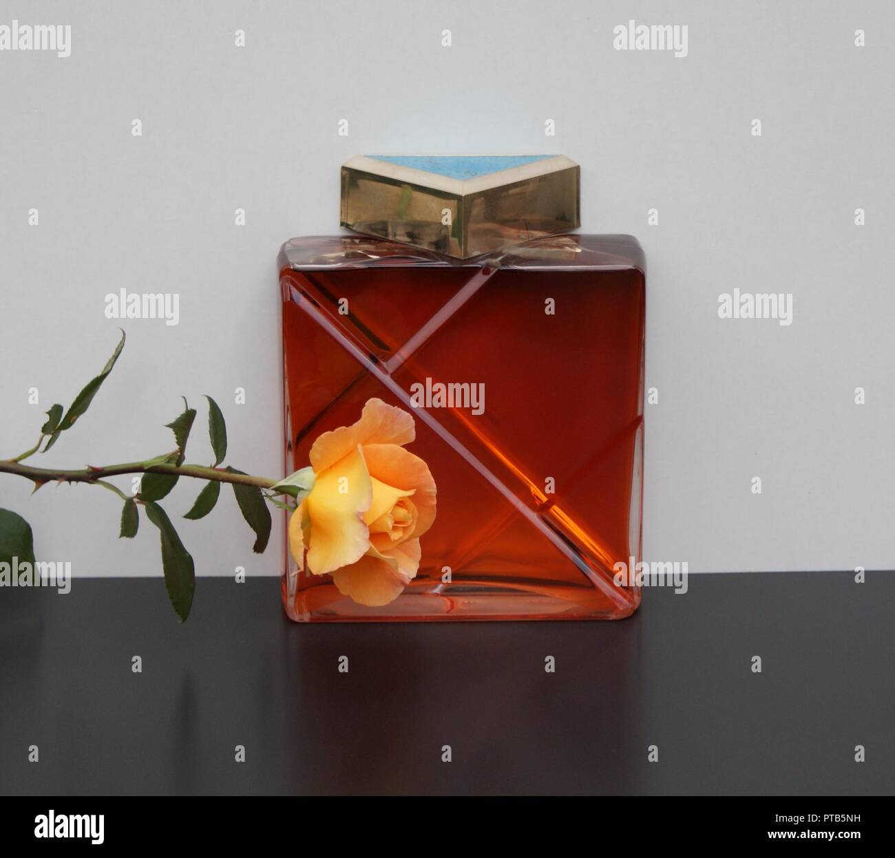 KL Homme, men's fragrance, large perfume bottle decorated with an English rose - Stock Image