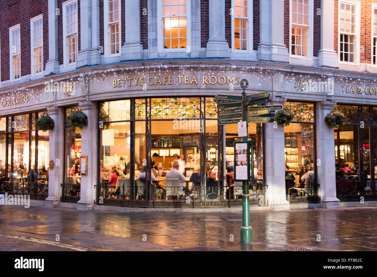 York, UK – 12 Dec 2016: A Christmas shoppers take a break and refreshments at Bettys cafe and tea rooms on 12 Dec at St Helen's Square, York Stock Photo