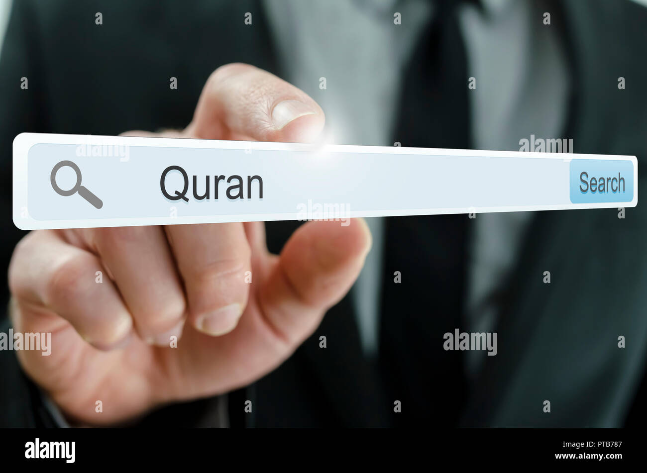 Word Quran written in search bar on virtual screen Stock Photo