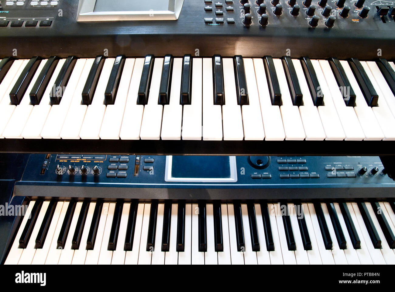 electronic synthesizer with keyboard and knobs closeup - Stock Image