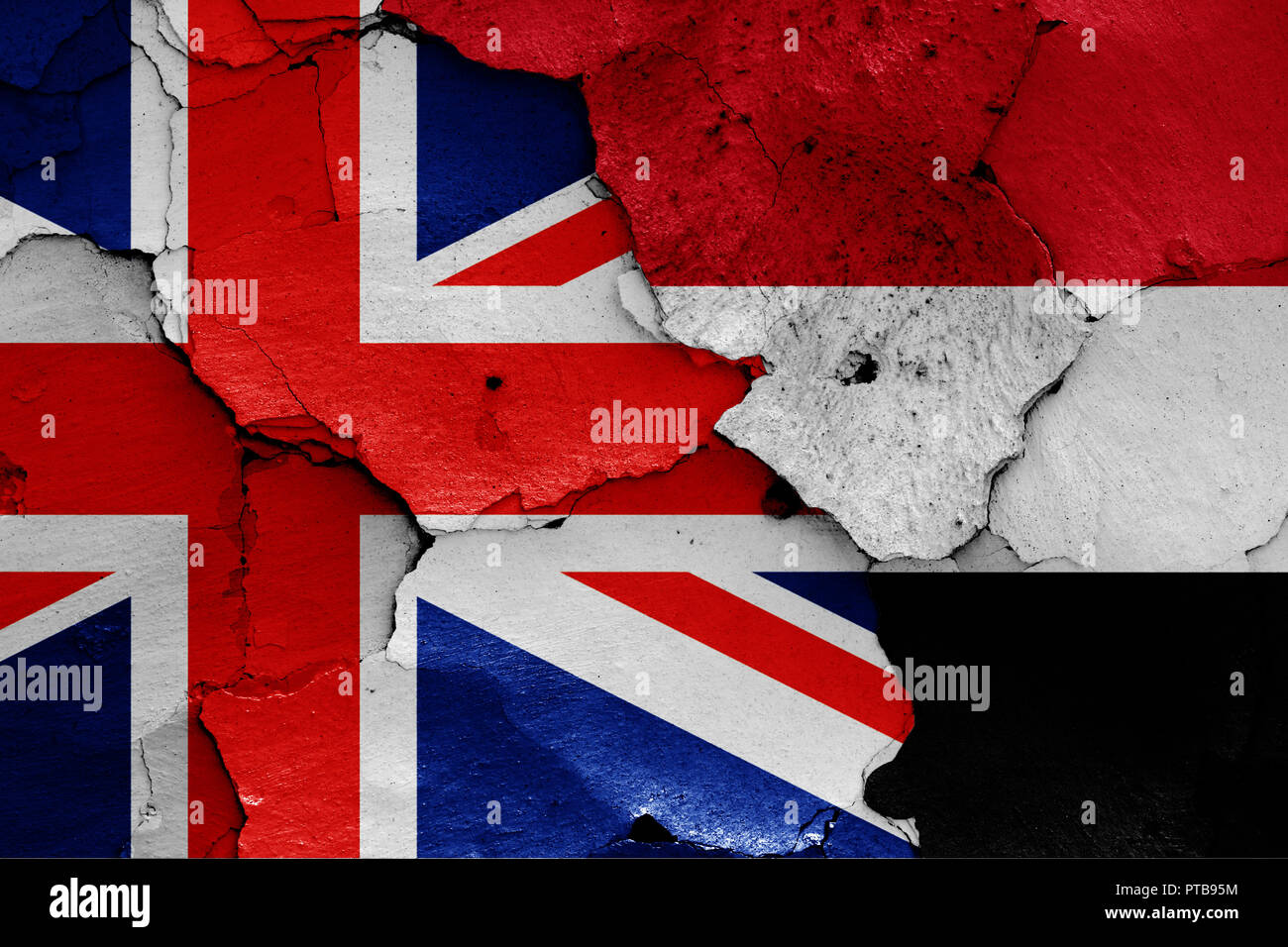 flags of UK and Yemen painted on cracked wall - Stock Image