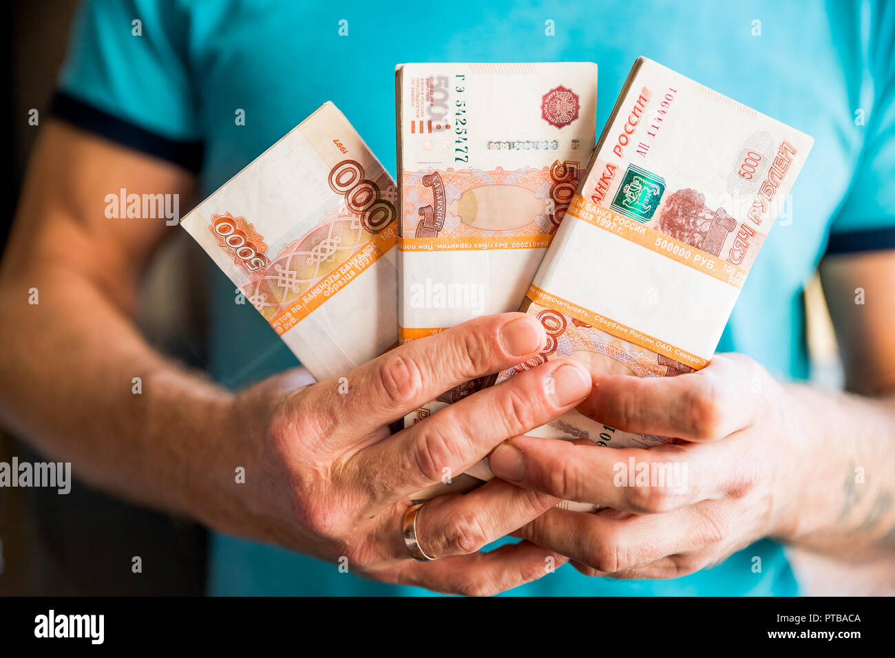 five thousandth banknotes of the russian ruble in a man s hand male