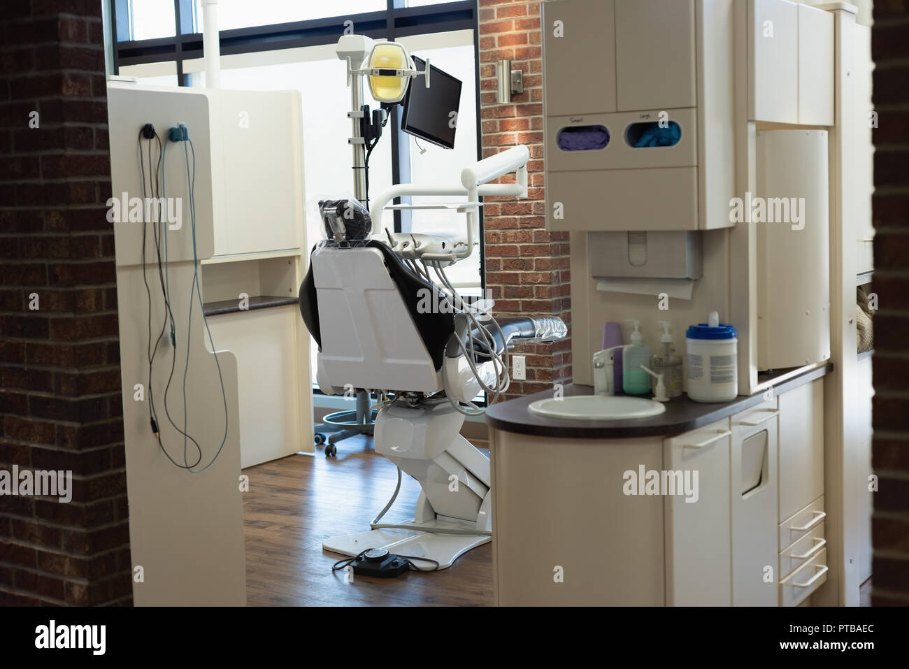 Professional dentistry chair in dental clinic - Stock Image