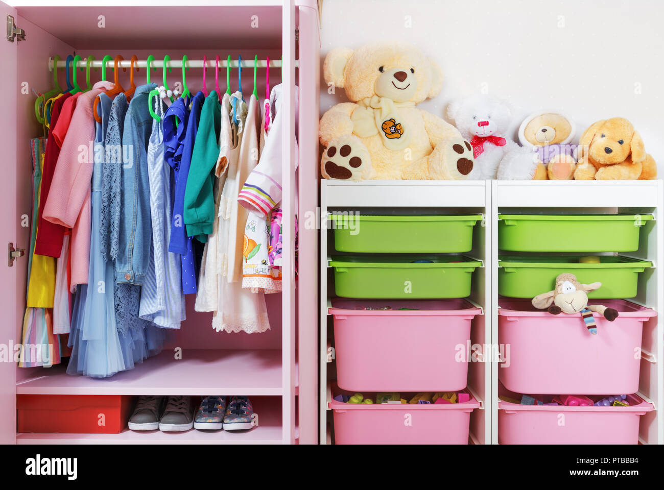 Wardrobe in the children's room. Storage system and storage for the concept of children's things and toys. Stock Photo