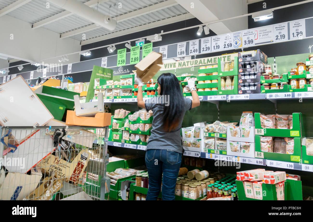 Lidl Supermaket Worker Stacking Shelves In Store Spain