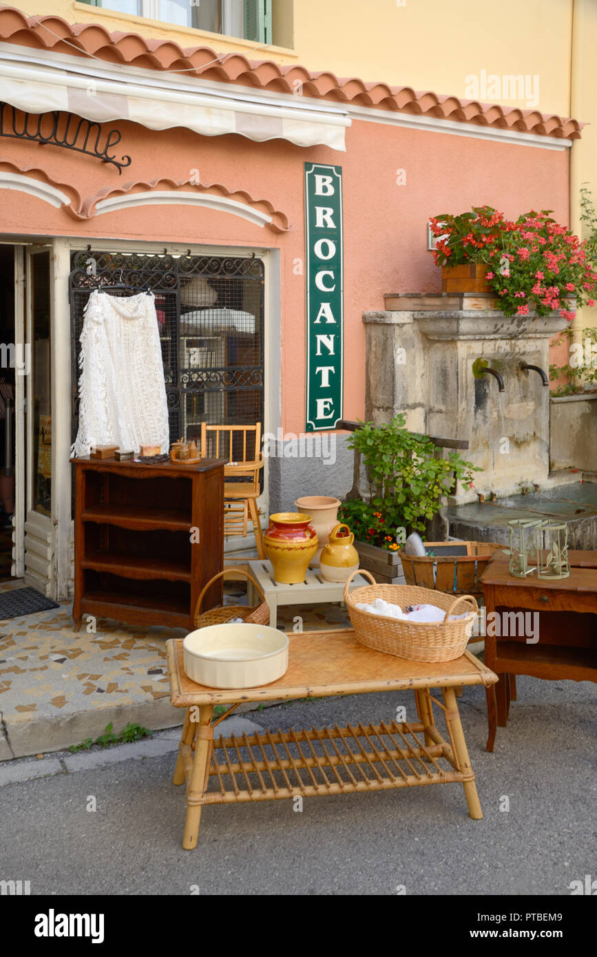 Display of Antiques Outside an Antique Shop or Brocante in Colmars-les-Alpes Provence France - Stock Image