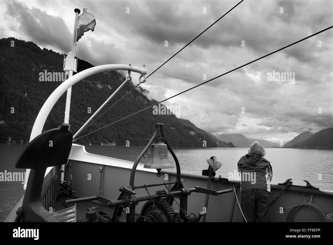 PS Lötschberg (built in 1914 by Escher-Wyss, Zurich) under way on the Brienzersee on a cloudy day, and approaching Giessbach.  Black and white version - Stock Image