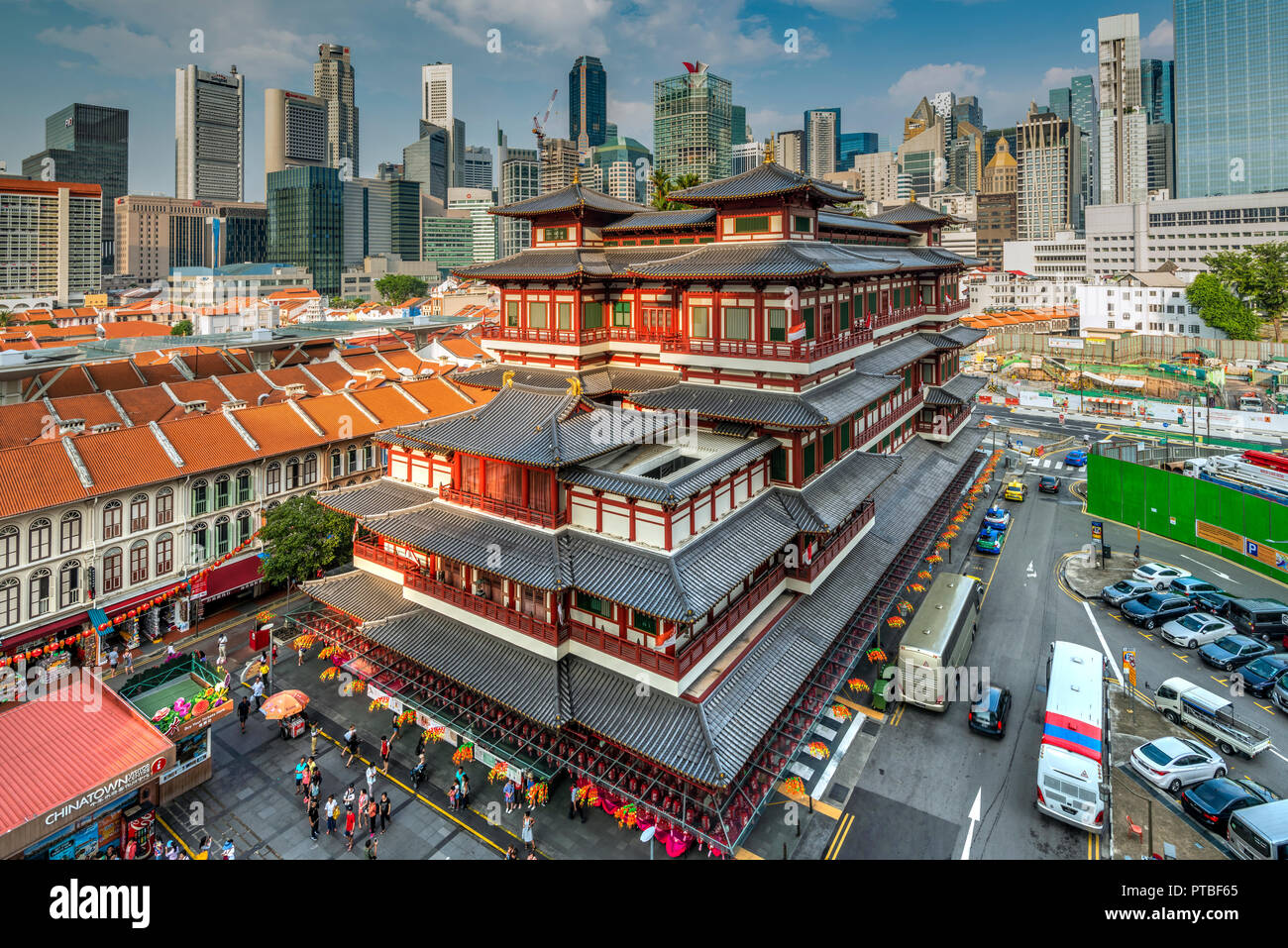 Buddha Tooth Relic Temple and city skyline, Singapore - Stock Image
