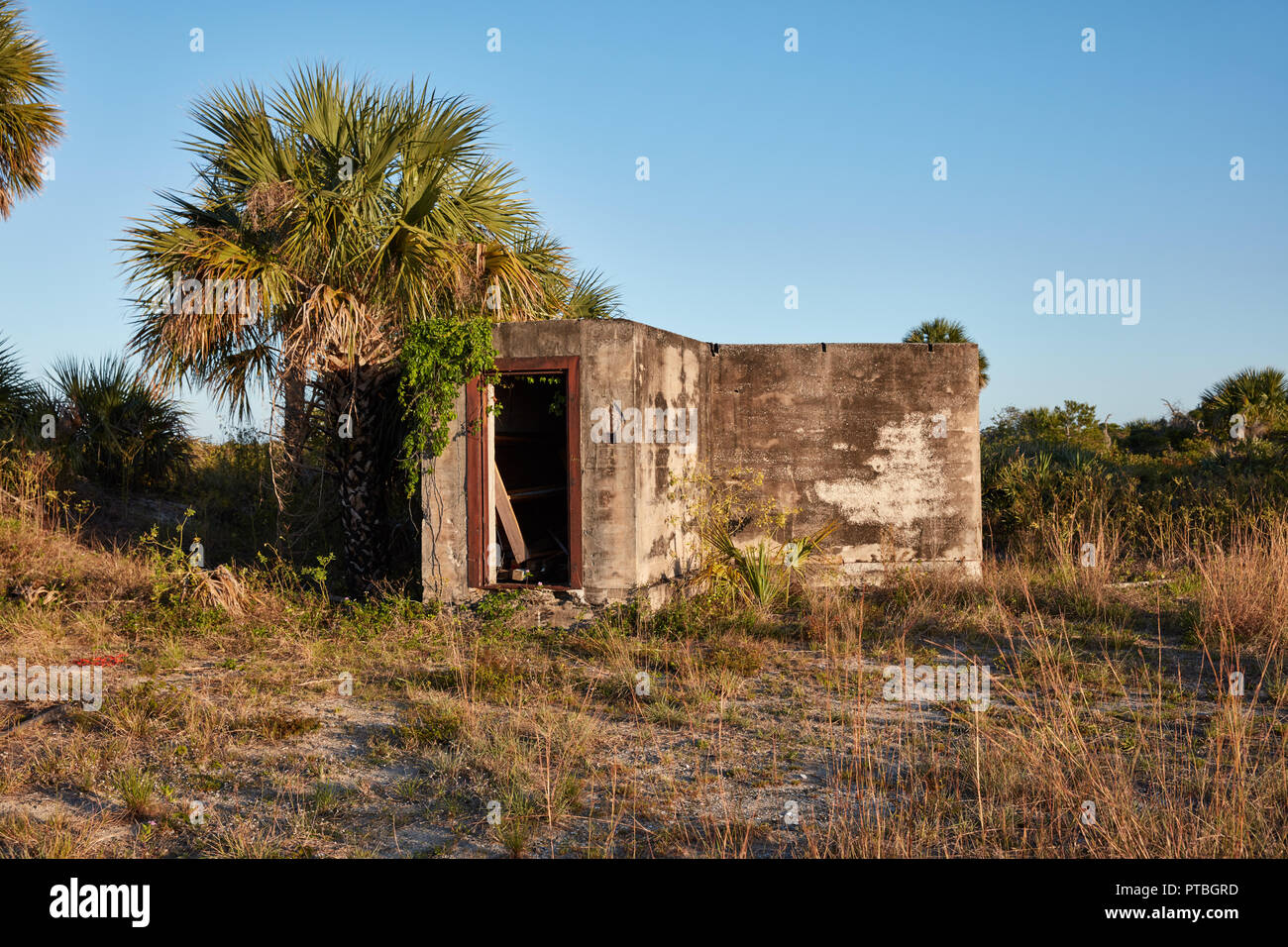 Abandoned concrete bunker on the grounds of the former United States military base Camp Murphy, now Jonathan Dickinson State Park, Florida - Stock Image