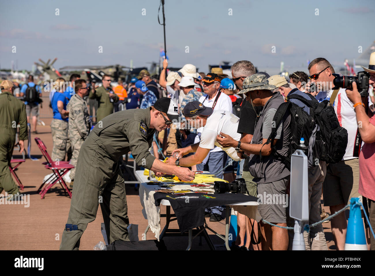 Crowds of people at the Royal International Air Tattoo, RIAT, RAF Fairford, in the Cotswolds. Aircraft enthusiasts shopping for souvenirs from crews Stock Photo
