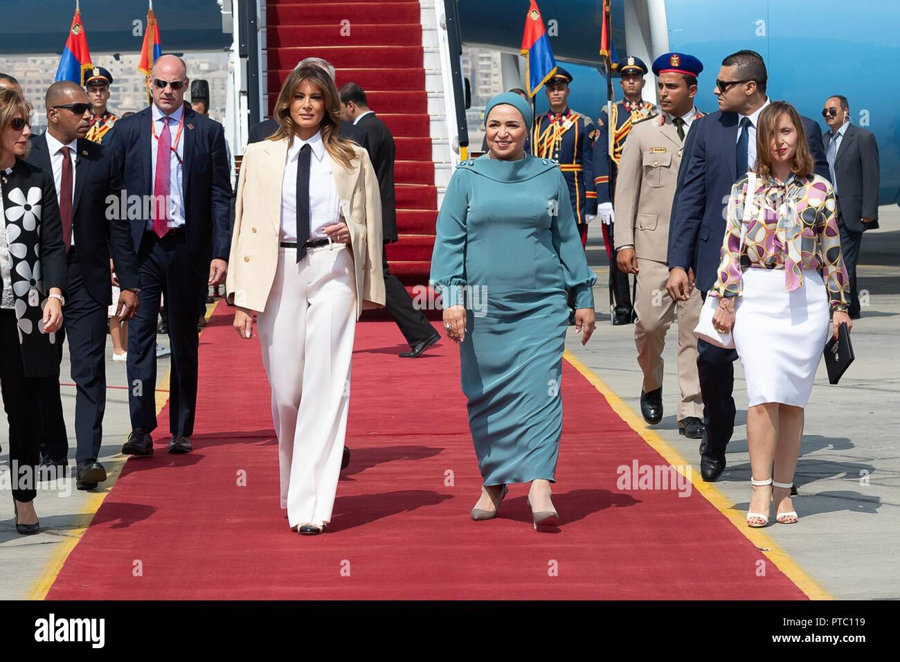 U S First Lady Melania Trump, left, is escorted by Egyptian