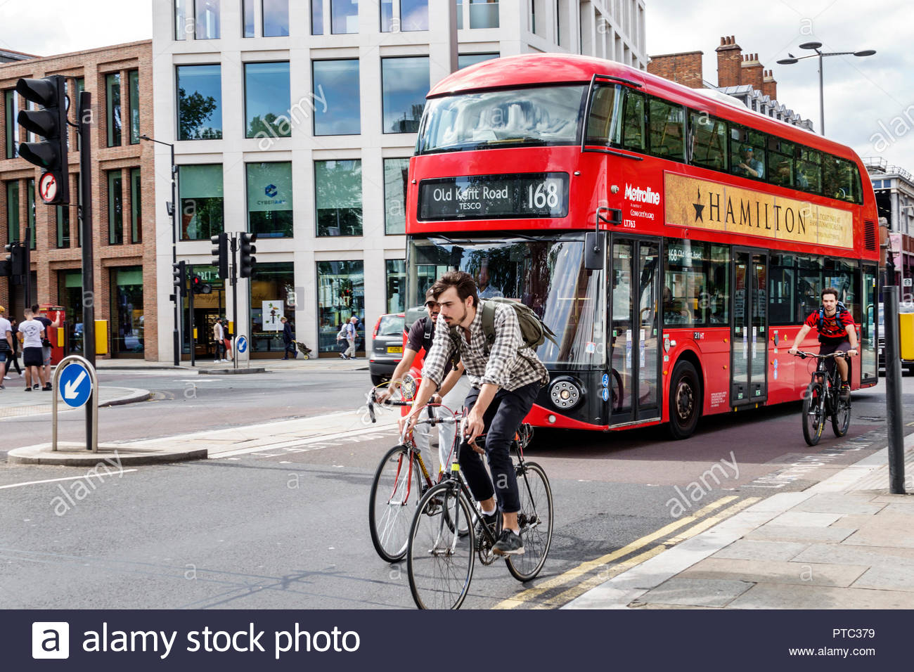 London England United Kingdom Great Britain Lambeth South Bank Waterloo Road shared bike traffic lane Metroline red double-decker bus public transport - Stock Image