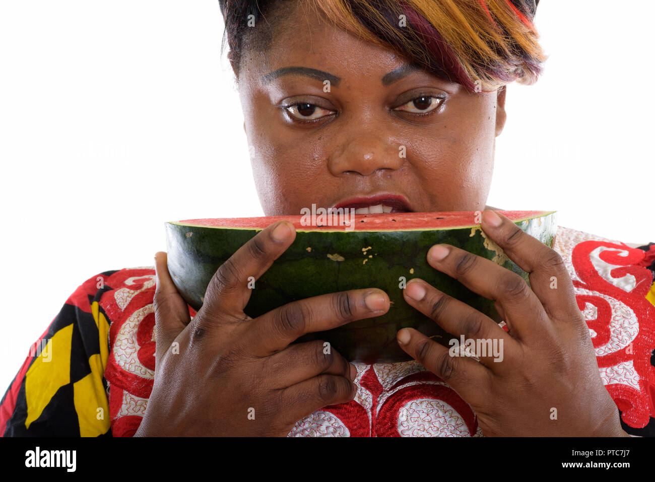 Close Up Of Fat Black African Woman Eating Slice Of Watermelon