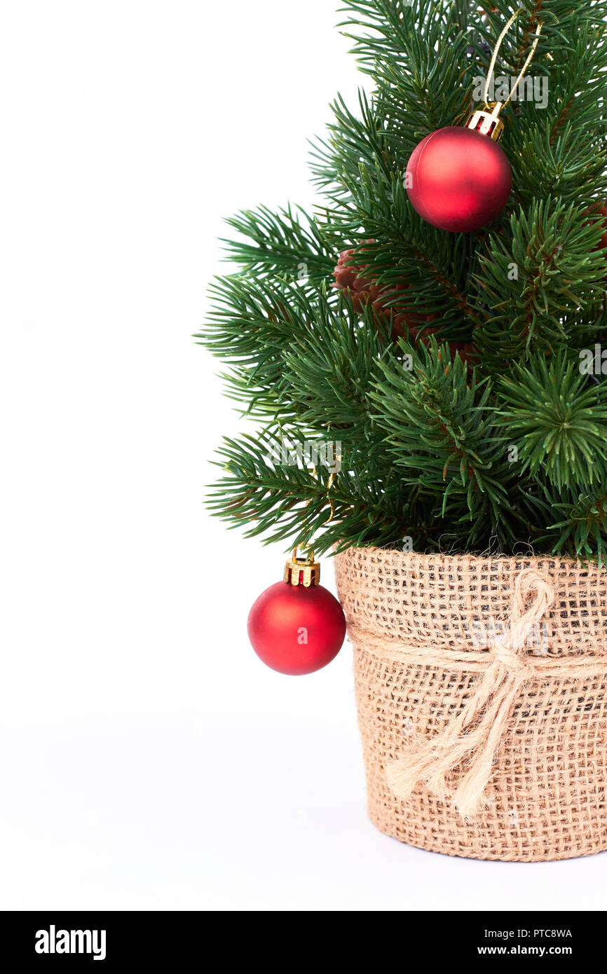 Decorative Christmas Tree With Baubles Small Green Christmas Tree In Burlap Isolated On White Background New Year And Christmas Concept Stock Photo Alamy
