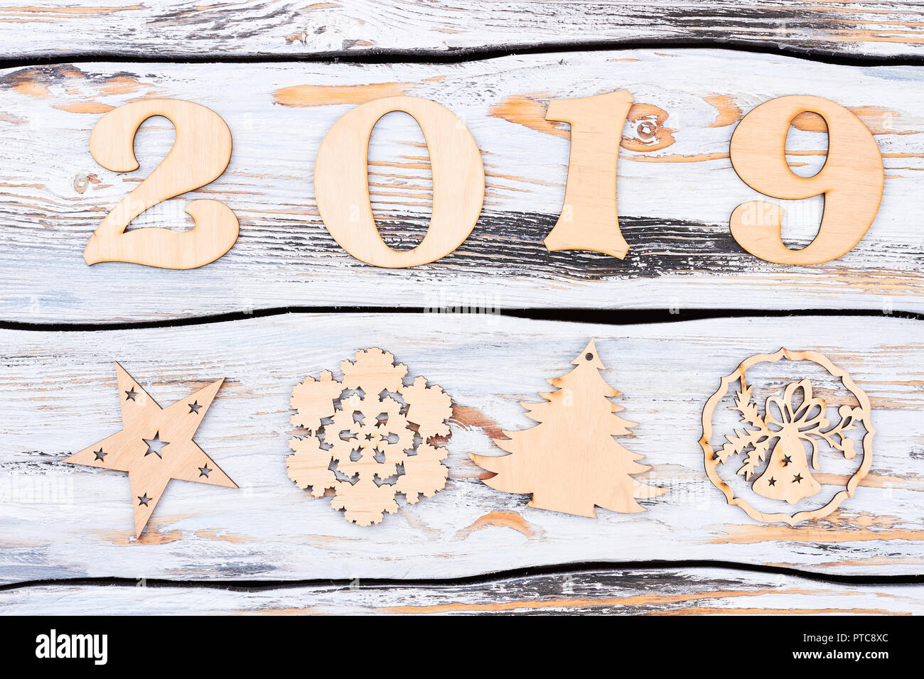Wooden Number 2019 And New Year Figures New Year Number 2019 From The Wooden Digits And Carved Wooden Christmas Tree Snowflake Candles Deer On Vin