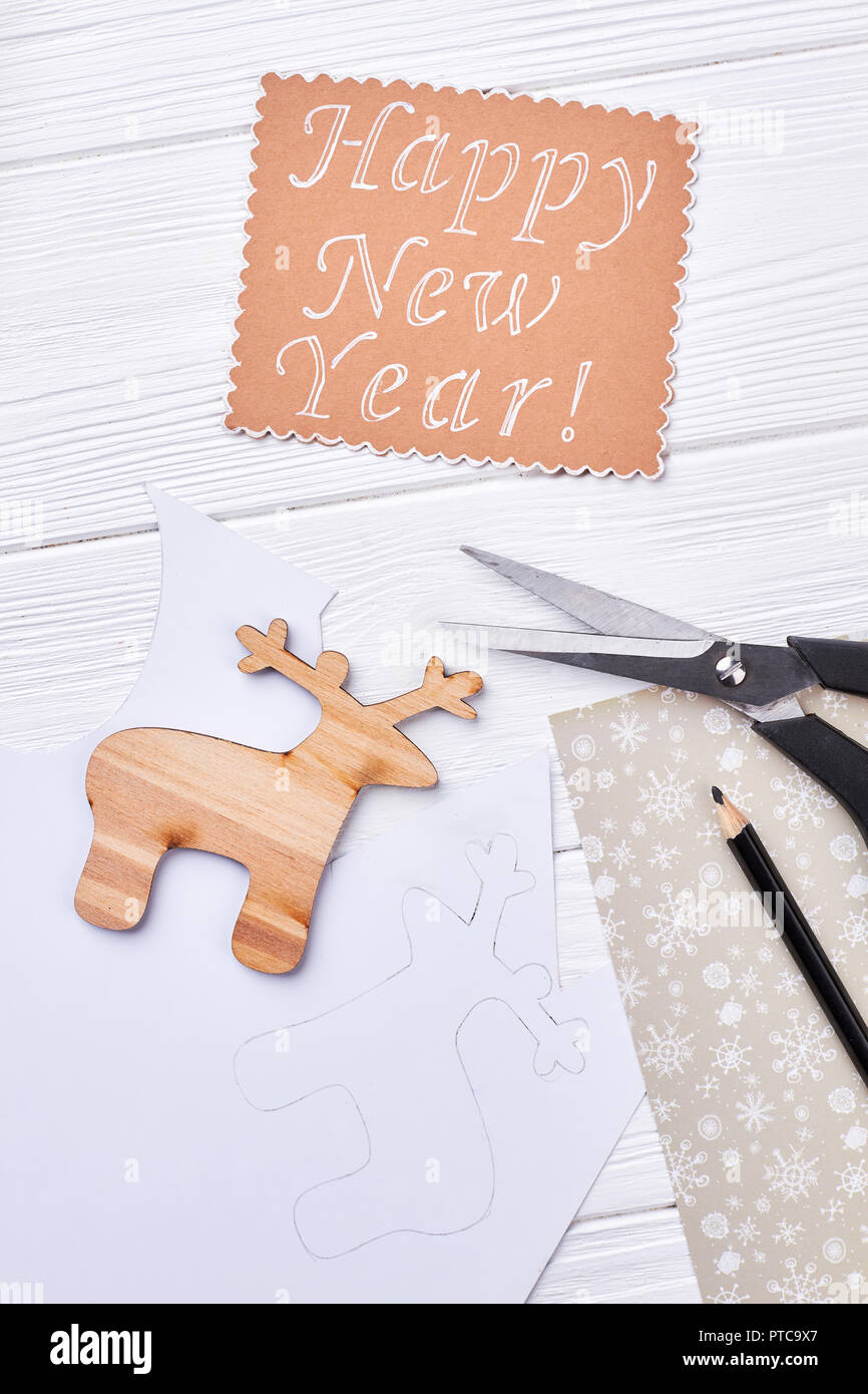 cut out wooden deer paper message new year handicraft from wood and paper on wooden background top view happy new year