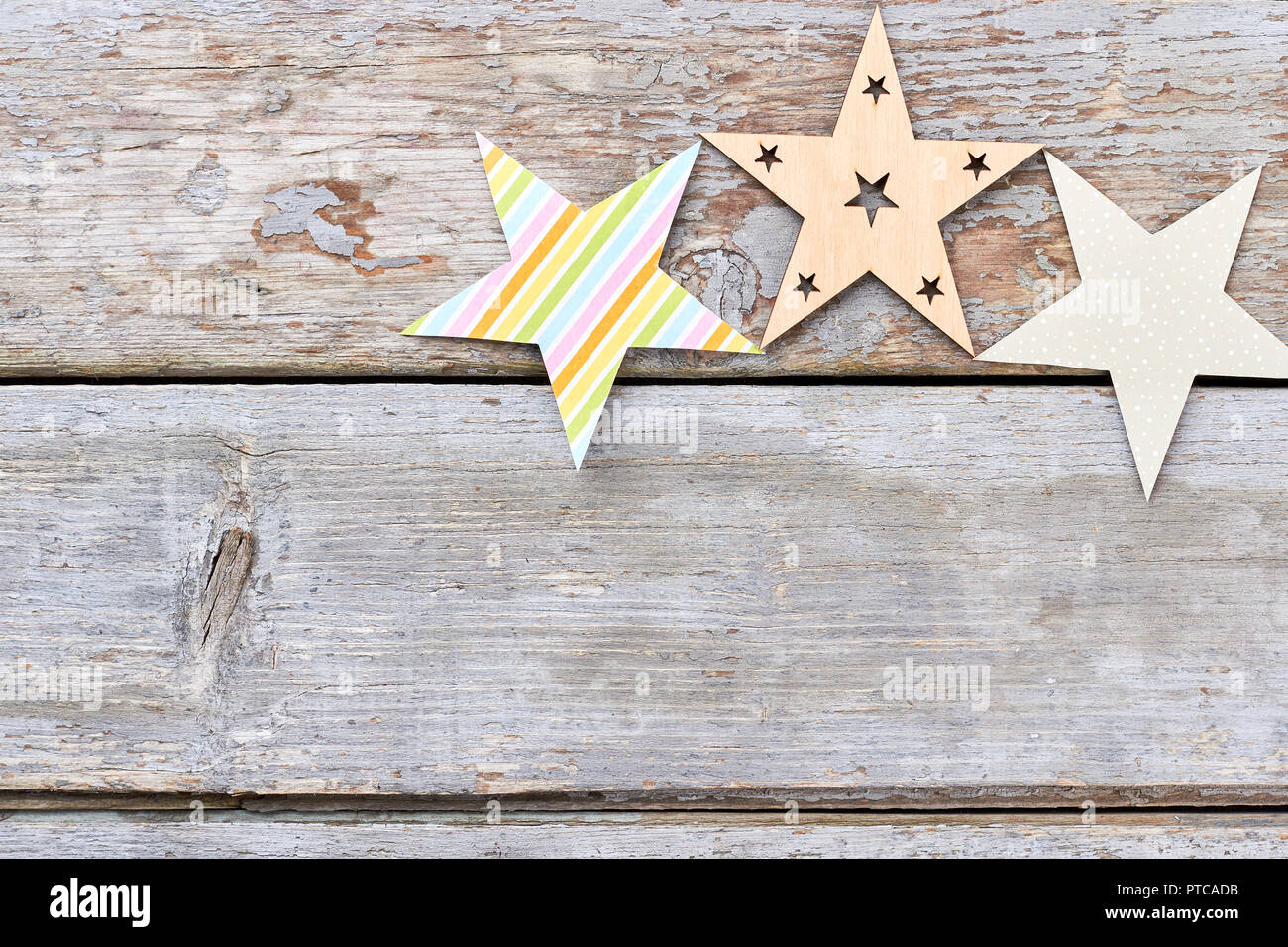 handmade christmas decorations stars paper and wooden cut out decorative christmas stars on old wooden background copy space