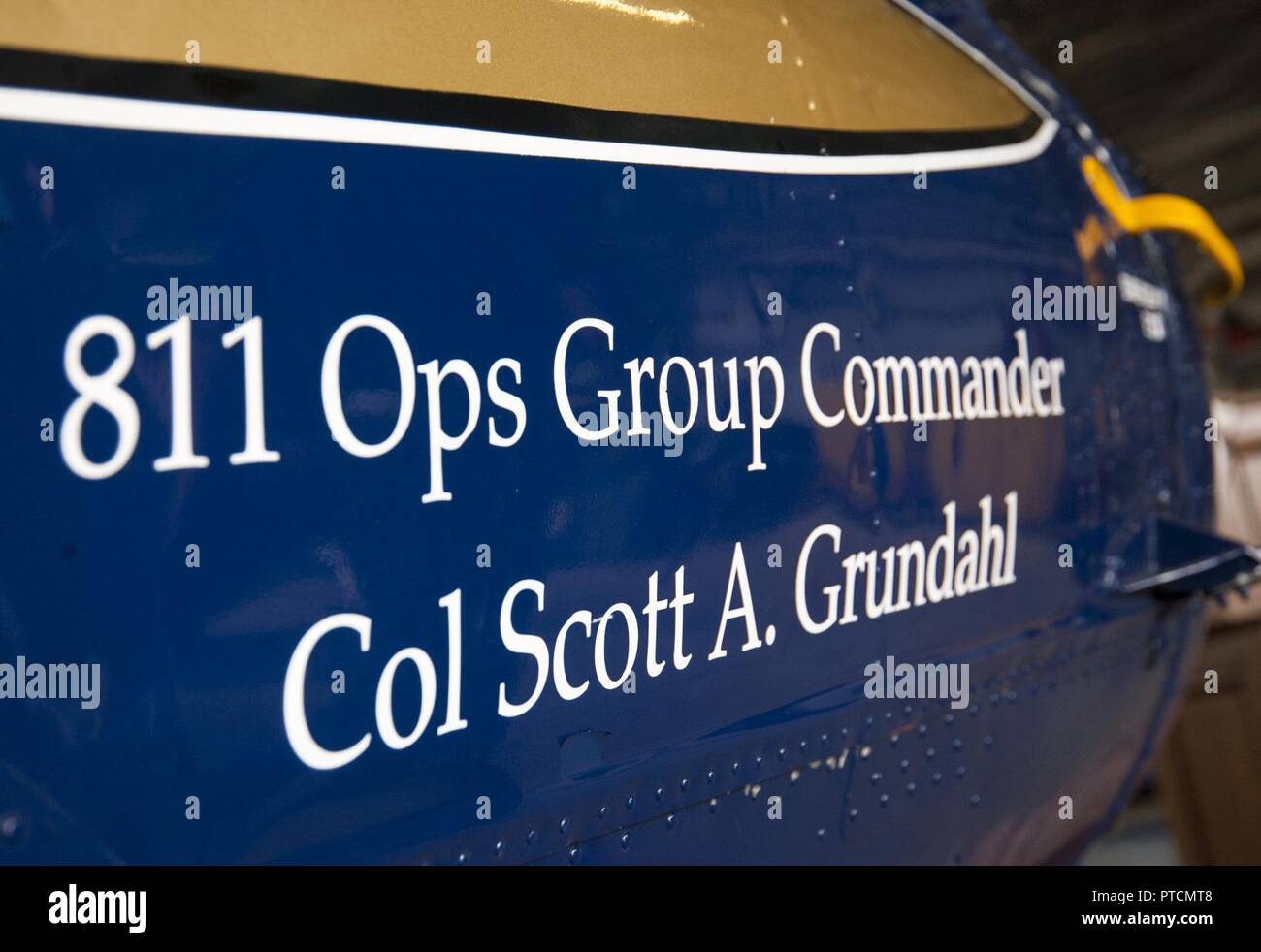 The 811th Operations Group unveiled incoming commander Col. Scott A. Grundahl's name on a UH-1N Iroquois helicopter during the group's change of command ceremony at Joint Base Andrews, Md., July 7, 2017. The group consists of the 811th Operations Support Squadron and the 1st Helicopter Squadron both of which provide the National Capital Region with continuous rotary-wing contingency response. - Stock Image