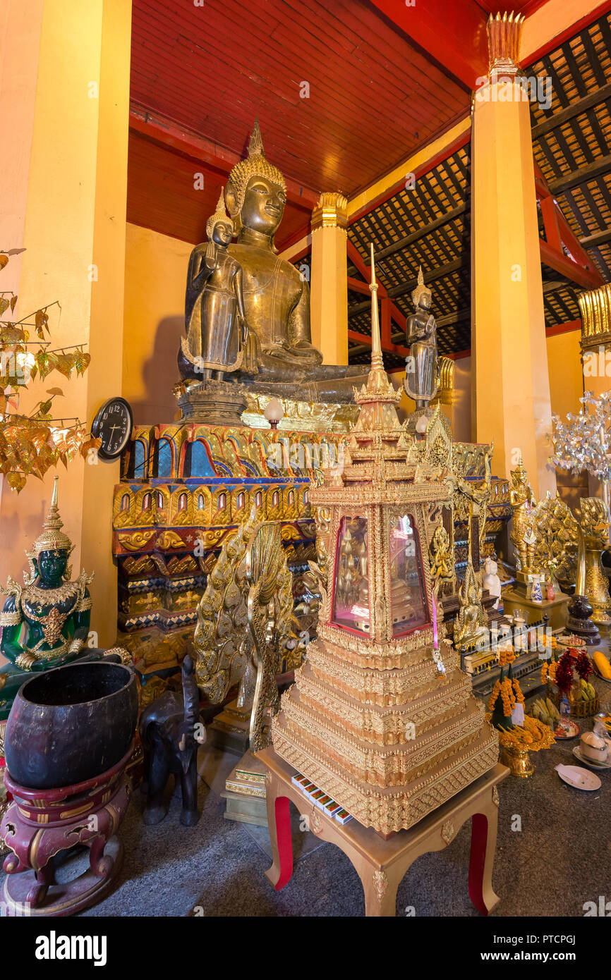 Altar with many golden Buddha statues and other items at the Wat Ong Teu Mahawihan (Temple of the Heavy Buddha), a Buddhist monastery, in Vientiane. Stock Photo