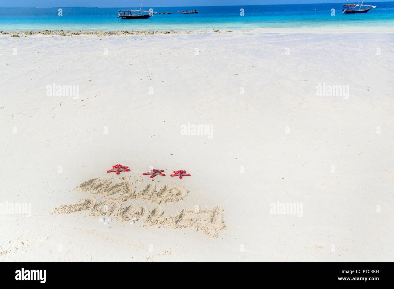merry christmas written in Estonian on the sand, zanzibar , nungwi paradise beach, africa - Stock Image