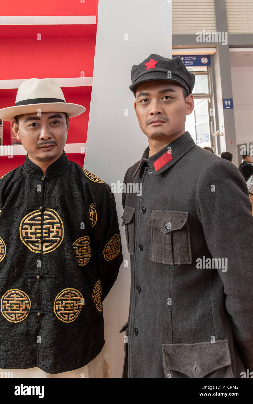 Two Chinese men dressed in vintage clothing of World War II in Xian, China - Stock Photo
