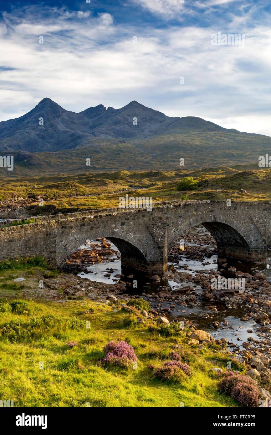 Old Stone Bridge over River Slichagan with the Black Cuillin Mountains beyond,  Slichagan, Isle of Skye, Scotland - Stock Image